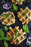 Savory waffles with cheese, ham, olives and herbs royalty free stock image