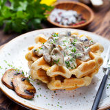 Savory waffles with corn, mushroom creamy sauce on a plate Stock Image