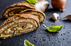 Savory whole wheat roulade stuffed with Tofu cheese, onion, garlic and herbs. Baked savory whole wheat roulade stuffed with Tofu cheese, onion, garlic and herbs Stock Photo