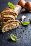 Savory whole wheat roulade stuffed with Tofu cheese, onion, garlic and herbs. Baked savory whole wheat roulade stuffed with Tofu cheese, onion, garlic and herbs Royalty Free Stock Photography