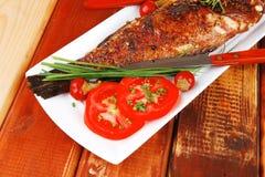 Savory on wood: fryed sunfish Royalty Free Stock Image