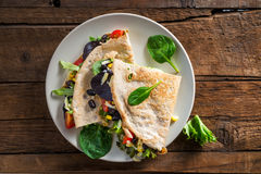 Savoury Buckwheat Pancake or Quesadilla. Healthy Warm Snack from Savoury Buckwheat Pancake or Quesadilla with Black Beans, Corn, Cherry Tomatoes, Rocket Salad royalty free stock photos