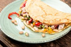 Buckwheat Pancake. Mexican Quesadilla. Savoury Buckwheat Pancake with White Beans, Red and Yellow Bell Pepper, Parsley and Chicken. Mexican Quesadilla royalty free stock images