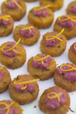Savoury delights. A small fishcake with an beetroot garnish Royalty Free Stock Image