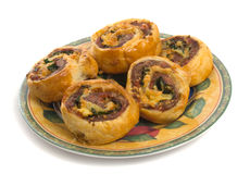 Savoury Pinwheels over white background Royalty Free Stock Images