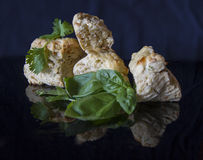Savoury scones with fresh herbs on black background Stock Images