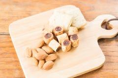 Savoury snack on wooden dish Stock Photo