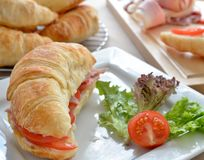 Savoury Tomato Croissant with Side of Lettuce and  Royalty Free Stock Images