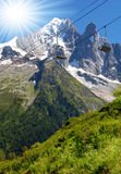 Savoy Alps in France. Savoys Alps and the cable car and the sun Royalty Free Stock Image