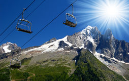 Savoy Alps in France. Savoys Alps and the cable car and the sun Stock Photo