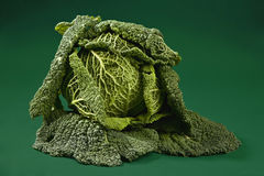 Savoy cabbage against green background, close up Royalty Free Stock Photos