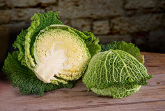 Savoy cabbage. Fresh sliced savoy cabbage on wooden table Royalty Free Stock Photography