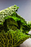 Savoy cabbage on grey background. Close up, copy-space, selective focus Royalty Free Stock Photo