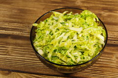 Savoy cabbage salad in glass bowl on wooden table Stock Photography