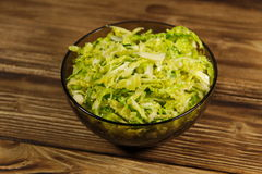 Savoy cabbage salad in glass bowl on wooden table Stock Images
