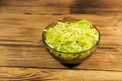 Savoy cabbage salad in glass bowl on wooden table Stock Image