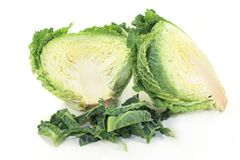 Savoy cabbage. A sliced savoy cabbage against white background Stock Photo