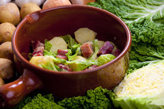 Savoy cabbage with smoked meat Royalty Free Stock Images