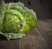 Savoy cabbage. On wooden background Stock Images