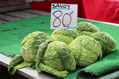 Savoy cabbages for sale on a market stall. Fresh Savoy cabbages for sale at a market royalty free stock photo