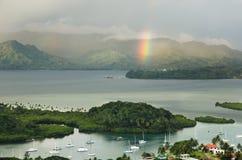 Savusavu marina and Nawi islet, Vanua Levu island, Fiji. Savusavu marina and Nawi islet with rainbow, Vanua Levu island, Fiji, South Pacific stock photos