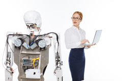 Savvy talented scientist coding the functions of the robot royalty free stock photos