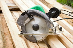 Saw. Electro a saw lies on boards Stock Images