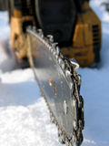 Saw. Teeth chain  moto saws in the snow Royalty Free Stock Images