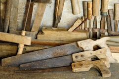Saw. Many handsaws on old wooden table Stock Photos