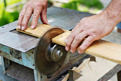 Saw Accident. Somebody about to get their thumb cut off from a power saw Royalty Free Stock Photography