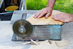 Saw Accident. Somebody about to get their thumb cut off from a power saw Royalty Free Stock Photo