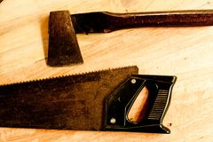 Saw and axe for carpenter on wooden background tool woodcraft object stock image