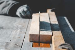 Saw blade. car saws wood. there is a blackboard in the background. working hand. Carpenter craftsman person sawing electric furniture circle circular cut stock photography