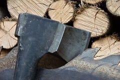 Saw blade for circular saw and ax. Saw blade for circular saw and ax Royalty Free Stock Photos
