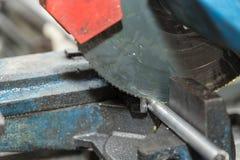 Saw blade cuts metal - detail stock photo