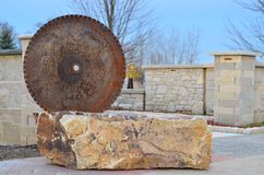 Saw Blade in the Stone Stock Image