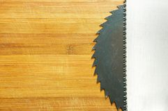 Saw blade and wood saw Royalty Free Stock Photography
