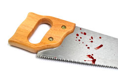 Saw with blood. Hand saw with droplet of blood, accident at work royalty free stock photos