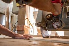Saw. Carpenter work with a circular saw stock photos