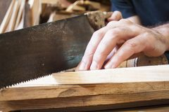 Saw on carpentry. Wooden background royalty free stock photography