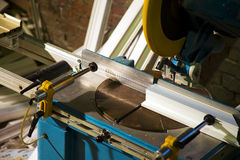Saw cut plastic - window manufacture Stock Image