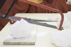 Saw cutting ice Stock Photo