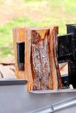 Saw cutting wood for winter. Modern machine lumber saw cutting firewood and logs. Wood industry. Royalty Free Stock Photo
