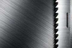 Saw edge on brushed metal Stock Photo