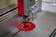 Saw of electric jigsaw in workshop close-up royalty free stock photography