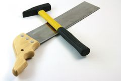 Saw and hammer Royalty Free Stock Photos