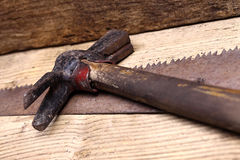 Saw and hammer on wooden table, carpentry Stock Image