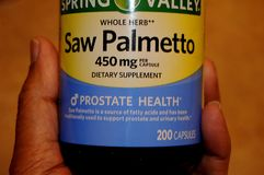 SAW PALMETTO DIETARY SUPPLEMENT. LEWISTON / IDAHO  USA  02. January 2018  _Saw Palmettoa wole herb 450mg dietary supplements prostate health.     Photo.Francis Royalty Free Stock Photography