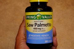 SAW PALMETTO DIETARY SUPPLEMENT. LEWISTON / IDAHO  USA  02. January 2018  _Saw Palmettoa wole herb 450mg dietary supplements prostate health.     Photo.Francis Royalty Free Stock Photos