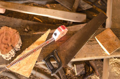 Saw with sawdust and pieces of wood. Saw with sawdust and pieces of wood Stock Photo